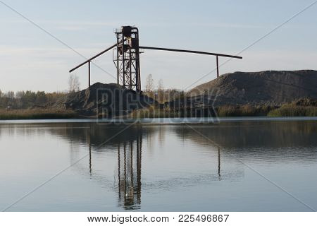 Rusty Metal And Concrete Structures On River. Old Abandoned Metal Structure On Stilts In The Water I