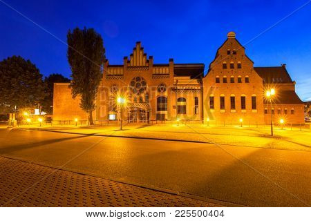 GDANSK, POLAND - JUNE 21, 2017: Architecture of the Baltic Philharmonic in Gdansk at night, Poland. Gdansk is the historical capital of Polish Pomerania.