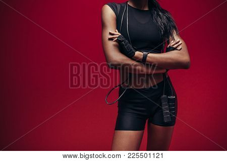 Fitness Woman Standing With Her Arms Crossed