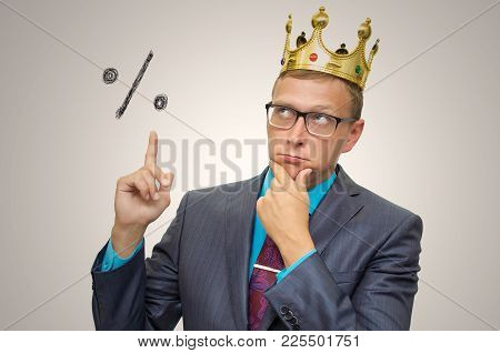 Thoughtful Business Man With Gold Crown Above His Head Calculates The Percentage And Showing Up By H