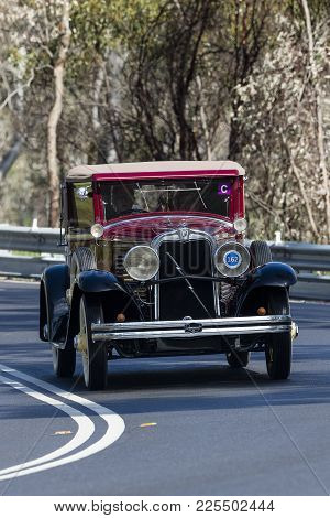 Adelaide, Australia - September 25, 2016: Vintage 1929 Marmon Roosevelt Collapsible Coupe Driving On