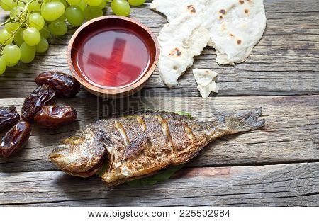 Easter Food With Fish Passover Bread Cross In Goblet Of Wine Last Supper Abstract