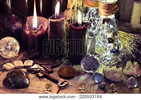 Magic Crystals, Ritual Objects, Runes, Black Candles And Bottles On Witch Table. Occult, Esoteric, D