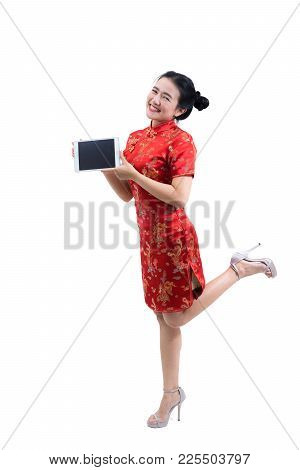 Portrait Of Asian Woman In Traditional Chinese Long Dress, Cheongsam, Black Hair, Presenting Tablet