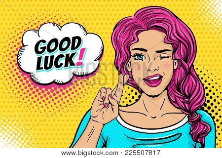 Pop Art Female Face. Sexy Young Woman Winks With Pink Hair And Open Smile, Crossed Fingers For Luck