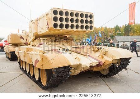 Nizhniy Tagil, Russia - September 26. 2013: Visitors Examine Military Equipment On Exhibition Range.
