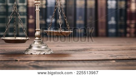Law And Justice, Legality Concept, Scales Of Justice L On A Wooden Background, Law Library Concept.