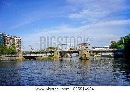 Kaliningrad, Russia - May 11, 2016: The Old Bridge Over The Pregolya River With Cars And Buses Under