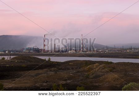 Pollution Of The Environment By Heavy Industry. Industrial Landscape At Sunset Sky. Metallurgical Pl