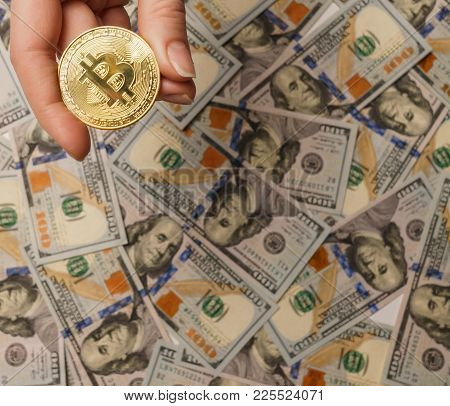 Golden Bitcoin Coins On A Paper Dollars Money And Dark Background With Sun. Crypto Currency. New Vir