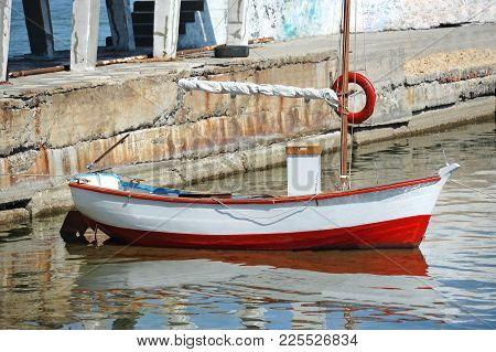 Motorboat In Jetty Over Harbor Pier, Odessa, Ukraine