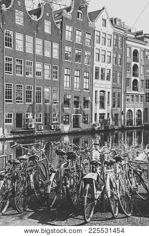 Amsterdam, Netherlands - April 3: Bicycles, Water Canal And Typical Architecture In City On April 3,
