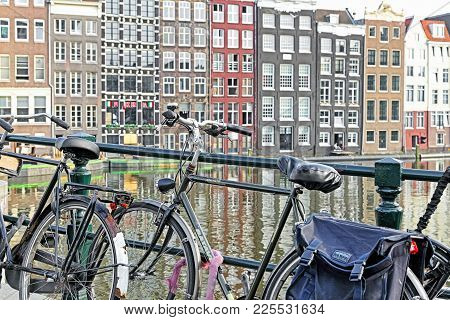 Amsterdam, Netherlands - April 3: Bicycle And Typical Architecture On April 3, 2014 In Amsterdam