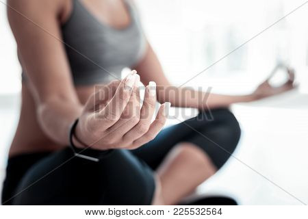 Calm And Healthy. Selective Focus On A Hand Of A Woman Having Beautiful Manicure Sitting On A Mat An