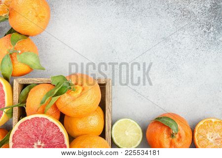 Citrus Background. Assorted Fresh Citrus Fruits With Leaves. Grapefruit, Lemon, Lime, Tangerine. Fla