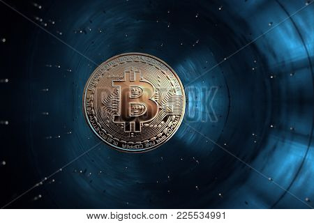 On A Blue Background In Accelerator Is Gold Coin Of A Virtual Digital Crypto Currency - Bitcoin For