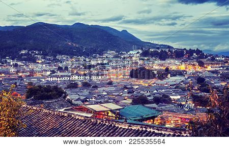 Color Toned Picture Of The Old Town Of Lijiang At Dusk. This Historical Center, Also Known As Dayan,