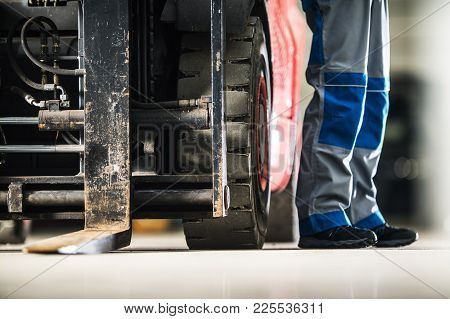 Operating Forklift Truck. Men And The Machine. Professional Lift Truck Operator Concept Photo.