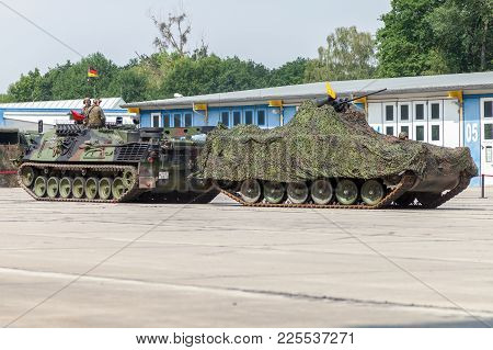 Burg / Germany - June 25, 2016: German Armored Recovery Vehicle, Bergepanzer 2 Pulls A Damaged Tank