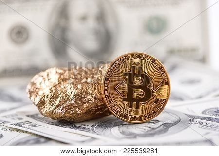 Golden Bitcoin As Main World Cryptocurrency And Gold Lump Presented On Dollar Banknote Background. T