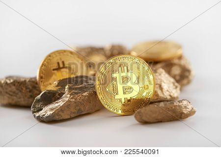 Encrypted Golden Bitcoins Lying Together With Gold Lumps Being Most Important Finance Trends Nowaday