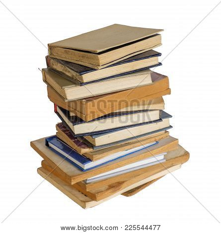 A Stack Of Dusty Shabby Books On A White Background, Isolated