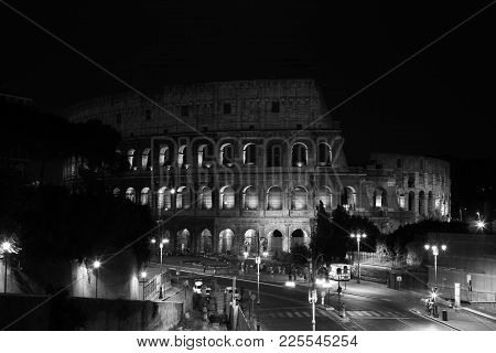 Summer. Italy. Rome. Night Colosseum With Illumination. Black And White Photo