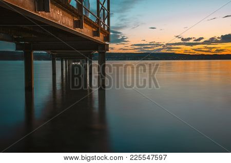 Sunset Over The Lake Of Constance With Golden Shiny Bridge