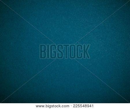 Poker table felt background in blue color