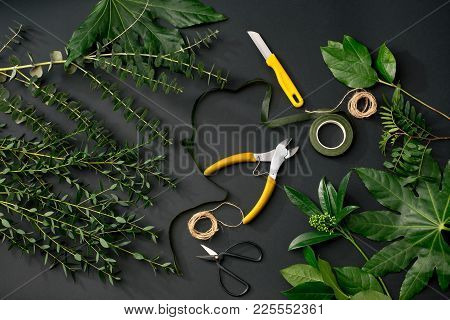 Tools And Accessories Florists Need For Making Up A Bouquet. The Black Florist Workplace. Top View.