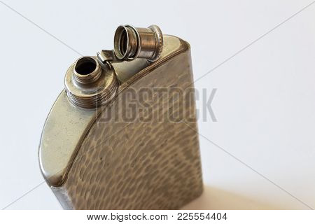 Open Old Metal Flask On A Diagonal, Drinking Alcoholism Addiction Concept, Copy Space, Horizontal As