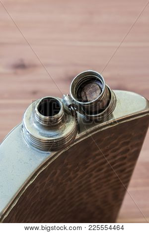 Top View Of Open Curved Flask, Drinking Alcoholism Addiction Concept, Copy Space, Vertical Aspect