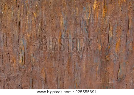 Background Of A Brown Stucco Coated And Painted Exterior, Rough Cast Of Cement And Concrete Wall Tex