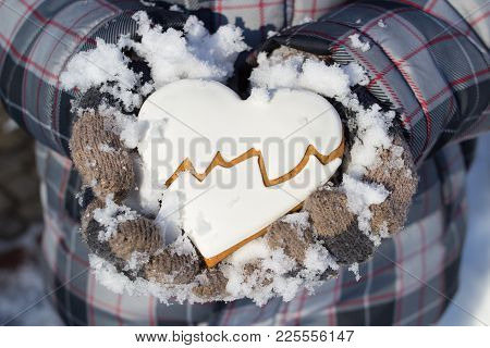 The Boy Holds Gloves Heart Cookies In The Winter