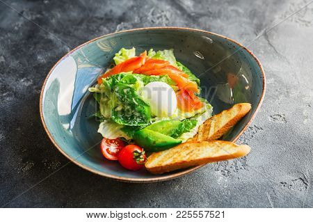 Caesar Salad With Egg, Salmon, Avocado, Cherry Tomatoes And Grilled Bread