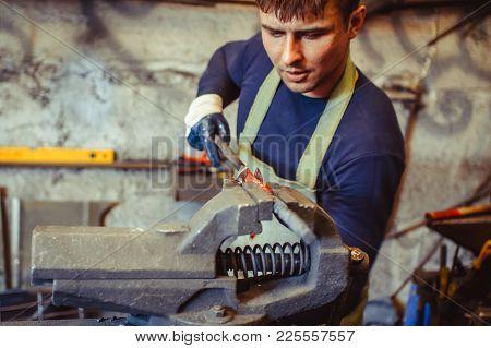 Industrial Machinist Working On Vice Grip In Workshop