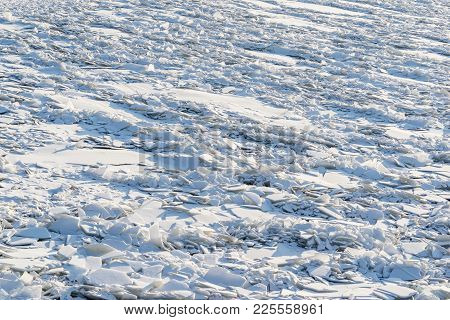 Landscape Of Abstract Texture Of Big Splinters And Pieces Of Ice And Snow Of Frozen Water Of The Riv