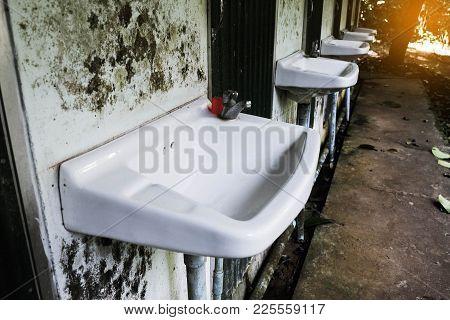 Dirty Clean Wash Basin In The Dirty Bathroom .