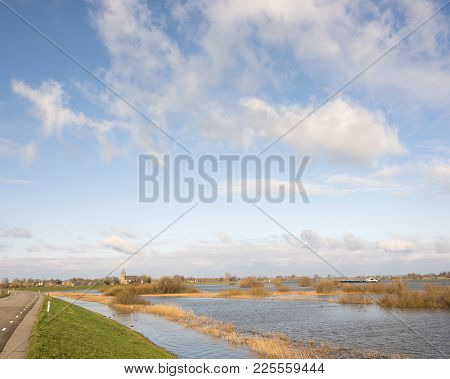 Ship On River Ijssel And Flooded Flood Plains Near Zalk Between Zwolle And Kampen In The Netherlands