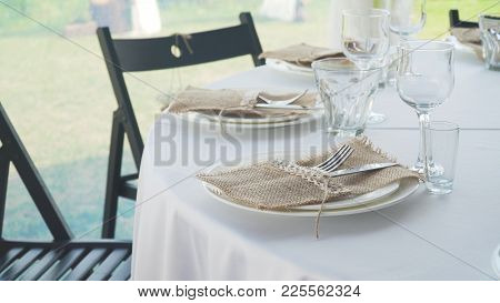 Banquet Decorated Table, With Cutlery. Serving Of A Festive Table, Plate, Napkin, Knife, Fork. Table