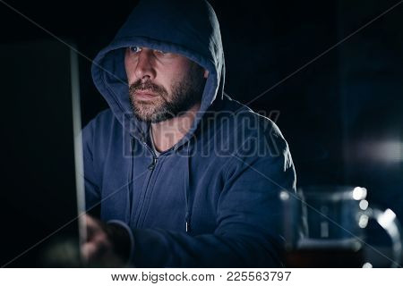 A Serious Hacker Is Sitting In A Dark Room