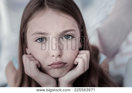 In The Blues. Beautiful Long-haired Grey-eyed Girl Feeling Sad And Disappointed And Her Eyes Showing