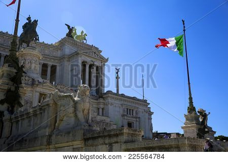View Of Italian National Flag In Front Of Altare Della Patria (altar Of The Fatherland) , The Equest