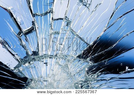 Textured Surface Of A Broken Mirror Coated With Small And Large White Cracks And Splinters