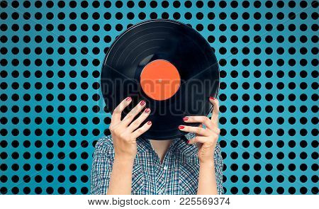 Retro Picture Of Woman With Vinyl Record On Blue Background With Black Dots