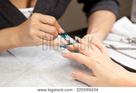 Picture Of Woman At Manicure Procedure At Spa Salon