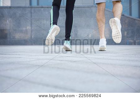 Male And Female Feet In Sneakers. Couple Running, Crop, Back View, Copy Space. Fitness, Sport, Foot