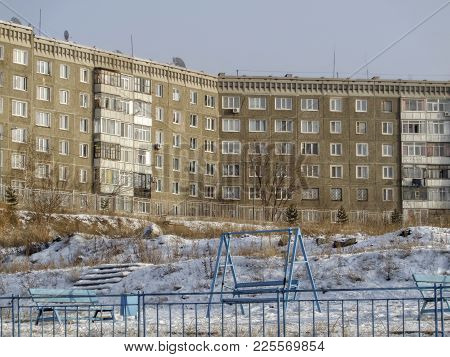 Old Multi-story Apartment Building On A Hill. Soviet Architecture, 1980s