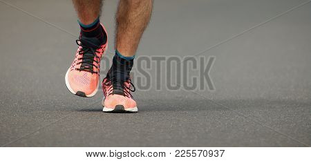 Runner Man Feet Running On Road Training For Fitness And Healthy Lifestyle