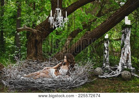 Fairy Tale Picture - Beautiful Sexy Brown-haired Model Girl Wears Lingerie, Rests In A Huge Nest In